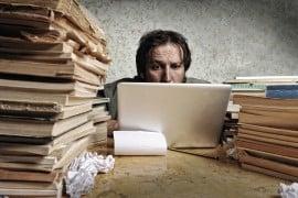 bigstock-Accountant-in-problems-Alone--26665823