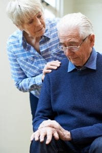 Senior Woman Comforts Husband with dementia need Alzheimer's & Dementia Asset Protection Planning